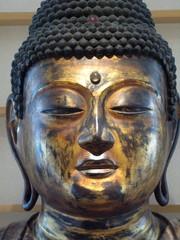 Tête de Bouddha doré.