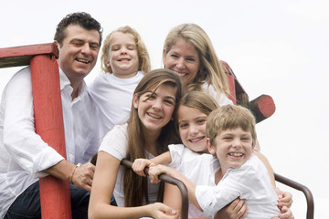 Portrait of family, mom and dad with their four children