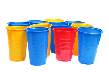 Stacked plastic cups isolated on white.