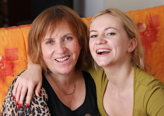 Beautiful and happy mum with a daughter of the house