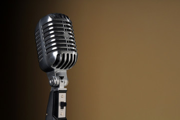 Vintage Microphone over Gradient Background