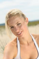 Portrait of beautiful blond female outdoors