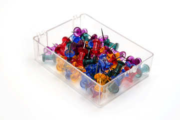 Colored push pins in a plastic box