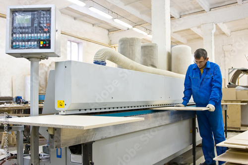 """operating working with wood paneling machine"" stock photo a."