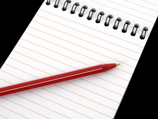 notepad with pen