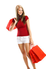 young smiling woman with shopping bags - isolated