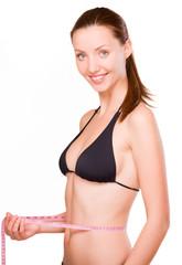 girl measures a waist