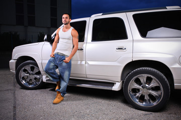 Young person standing next to an SUV