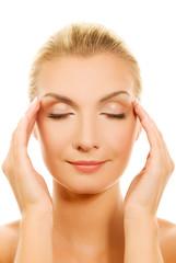 Beautiful woman massaging her head