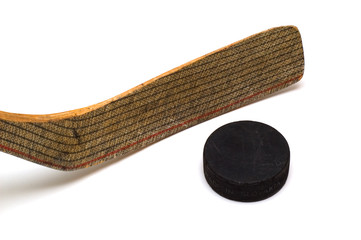 Hockey stick and puck on white background