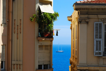 Monte Carlo glamour holiday: blue sea and yacht between two hote