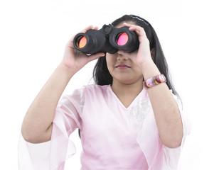 a cute asian teenage girl looking through the binocular