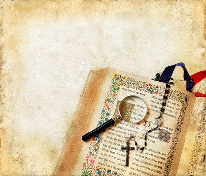 Bible, Rosary, and Magnifying Glass on a Grunge Background