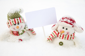 Two happy snowman  with sign