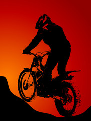 Fototapete - Silhouette of motobiker in the sunset