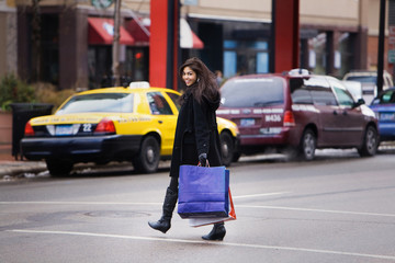 Women With Shopping Bags Crossing Street