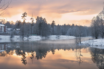 Winter evening landscape with lake