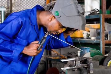 african welder in working