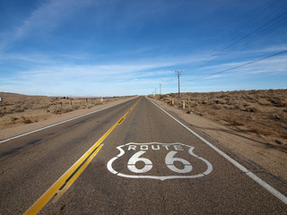 Foto op Textielframe Route 66 Historic Route 66 highway with pavement sign in the Mojave Desert area of Southern California.