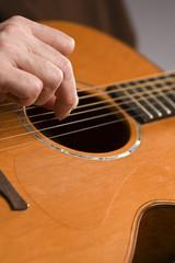 Acoustic guitar player fingerpicking