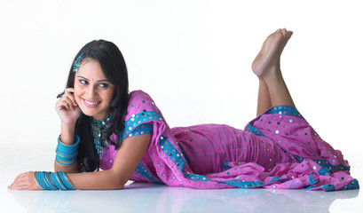 Asian girl lying on the floor with a smile
