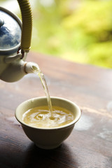 Pouring Green Tea from Pot
