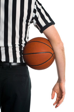 Male referee holding basketball isolated on white