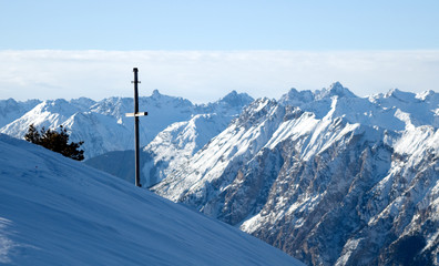 Winter mountains with cross
