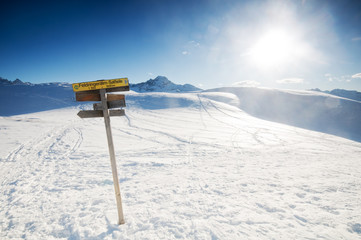 The signpost in the winter mountains
