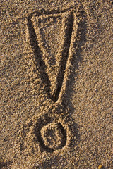 exclamation sign in sand
