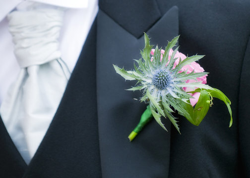 Scottish wedding Groom's buttonhole flowers and thistle
