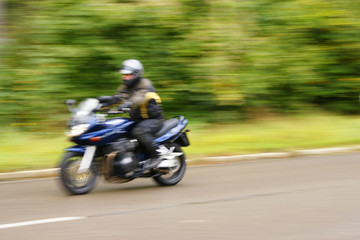 speed - danger - blurred motorcyclist