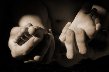 Dads hands with baby