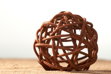 Sphere plaited from branches and roots