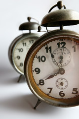 Old style metal clocks with alarm bell