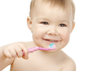Cute child cleaning teeth and smile