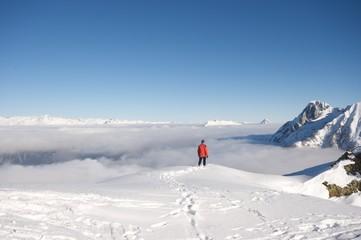 Bergsteiger über den Wolken