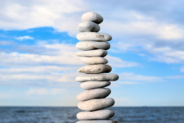 Grey stone tower on a beach