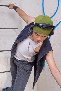 Asian rapper hanging on ladder