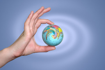 Hand holding a planet