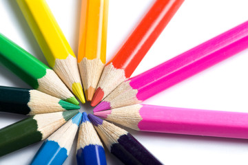 colored pencils in round shape isolated