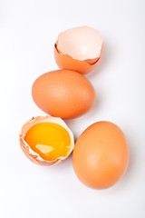 three fresh organic eggs isolated on a white background