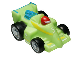 Rubber toy - the racing car on a white background