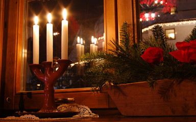 Atmospheric scenery with candles and flowers in  bowl