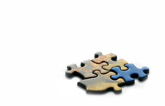 incorrect piece in a jigsaw; teamwork or creativity concept