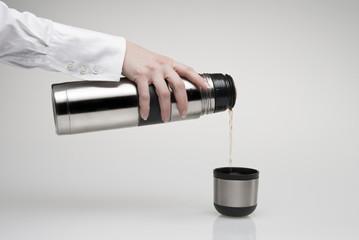 pouring thermos' mug