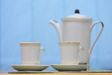 The porcelain coffee pot, two cups