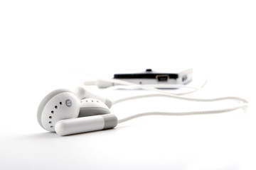 portable grey headphones with player on white background