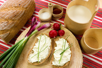 A slice of bread spread with sheep cheese (bryndza) with chives