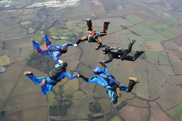 Five Skydivers form a star